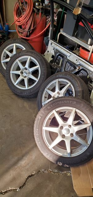 Scion xb wheels 4x100 185/60/15 some curb rash on 2 rims 2 tires are worn other 2 are good for Sale in Whittier, CA