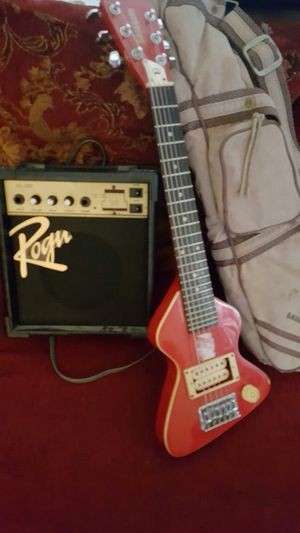 Mini guitar with amplifier case and pic included for Sale in Laurel, MD