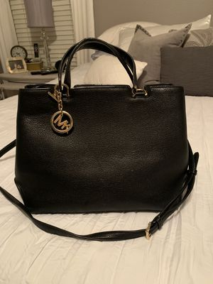 Black soft leather, Michael Kors purse. Normal wear and tear. Comes with storage dust bag. for Sale in San Marcos, CA