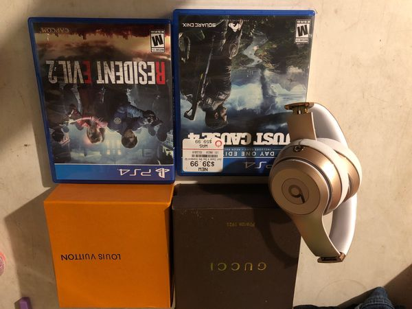 2 play station games 2 name brand belts and solo beats wireless message me for prices