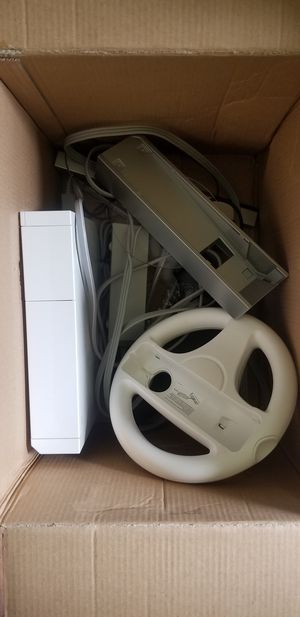 Wii system with controller, nunchuck, all cords and wheel. for Sale in Charlottesville, VA