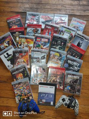 26 PS3 games and 2 controllers for Sale in Detroit, MI