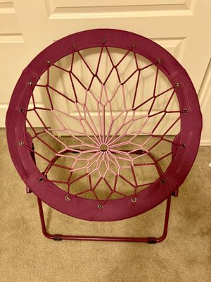 Purple to pink bunjo bungee kids chair or dorm chair or for play room can hold 200 lbs fun spiderweb chair for Sale in Gilbert, AZ
