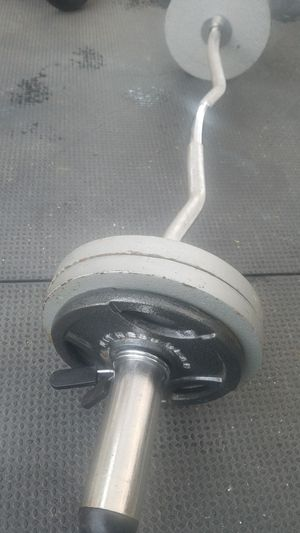 ( EXERCISE FITNESS 365 ) EXCELLENT CONDITION 65 LBS OLYMPIC CURL BAR WITH WEIGHTS for Sale in Long Beach, CA