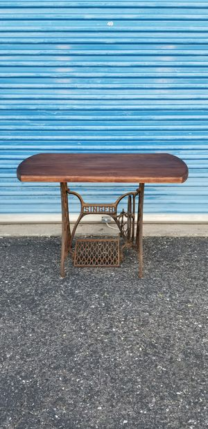 Rusty Singer sewing machine table base with solid wood top. for Sale in Phoenix, AZ