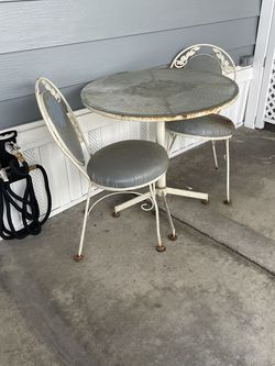 Iron Patio Table One Chair Is Wobbly But Can Be Fixed Upholstery Is Covered W Plastic And Is In Good Condition Price Reflects The Age And Wear for Sale in La Habra,  CA