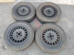 14 inch stock bmw e30 rims with tires 4x100mm lug pattern for Sale in Montebello, CA