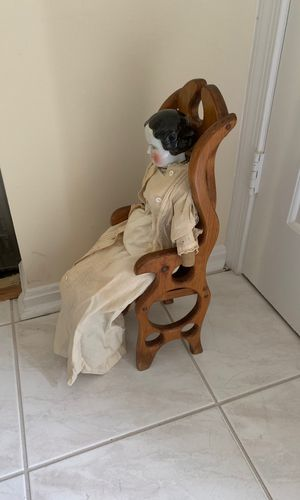 Antique porcelain head doll with wooden chair for Sale in Rockville, MD