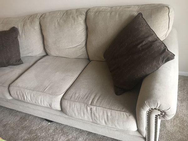 Cream sofa and love seat living room set