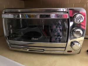 Oster, toaster oven with four accessories for Sale in Lincoln, RI