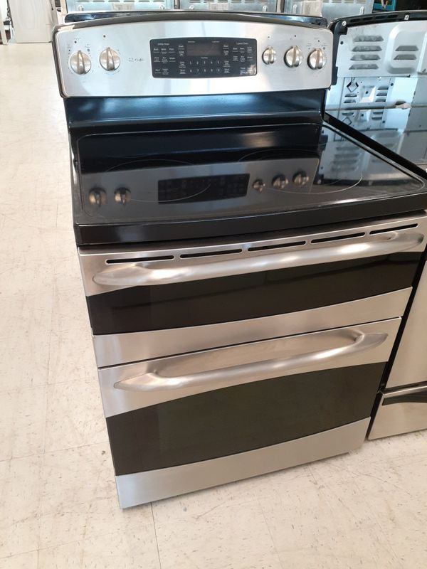 Ge double oven electric stove used in good condition with 90 day's warranty