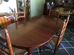 Solid cherry table and four chairs for sale. The set was custom made in West Paducah for my mother and comes with an additional leaf. for Sale in Benton, KY