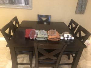 Bar height dining table with 6 chairs and 4 seat covers for each chair for Sale in Ceres, CA