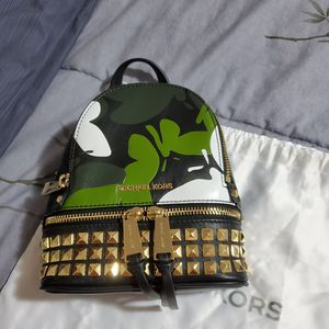 New authentic Michael Kors butterfly camo leather backpack for Sale in Lynnwood, WA