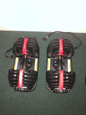 Bow flex adjustable dumbbells set. for Sale in Farmingdale, NY