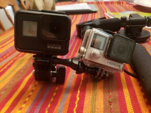 Gopro hero 7 black 4 silver and mounts for Sale in St. Petersburg, FL