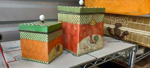 Two old tin boxes lidded closing cabissterst both have rooster decor both open one's a large and one's a medium they fit inside each other l for Sale in San Antonio, TX