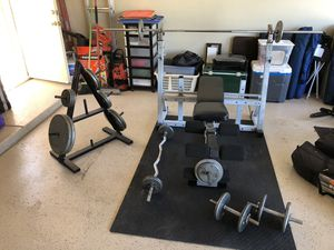 Weight set w bench, weight tree, mat and 300 lbs of weights for Sale in Phoenix, AZ