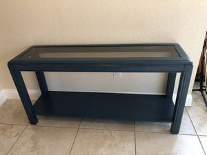 Blue wooden frame glass console table for Sale in Orlando, FL