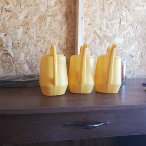 Yellow plastic watering cans for Sale in Hesperia, CA