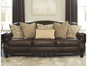 Signature Design by Ashley - Embrook Traditional Faux Leather Sofa w/ 6 Pillows, Chocolate Brown. DELIVERY AVAILABLE for Sale in Hilliard, OH