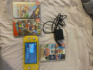 Nintendo switch lite 3 games works perfectly Mario all stars sealed for Sale in Miami, FL