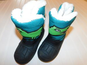 Cat & Jack kids boys size 10 snow boots... Teal green dinosaur for Sale in Tacoma, WA