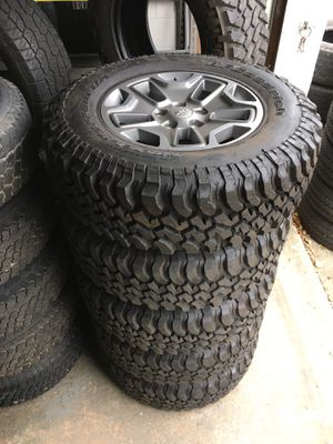 5) 255/75/17 BFGoodrich Mud Terrain KM Tires, with Jeep Rubicon wheels. for Sale in Crum Lynne, PA