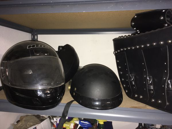 Motorcycle studded saddlebags brand new with support brackets $90. 2 helmets - full coverage and half helmet $45 both. Yamaha V-Star driver & passeng