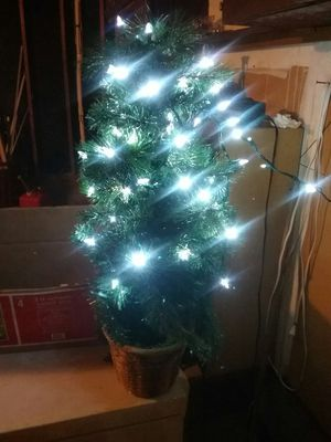 Pre-lit tree. Not all lights work. Needs no extra stand. Sits in basket for Sale in Tacoma, WA
