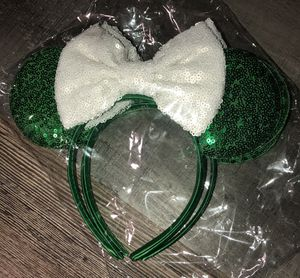 New in package over sized Minnie Mouse sequin headband w/ green ears & white bow for Sale in Pinellas Park, FL