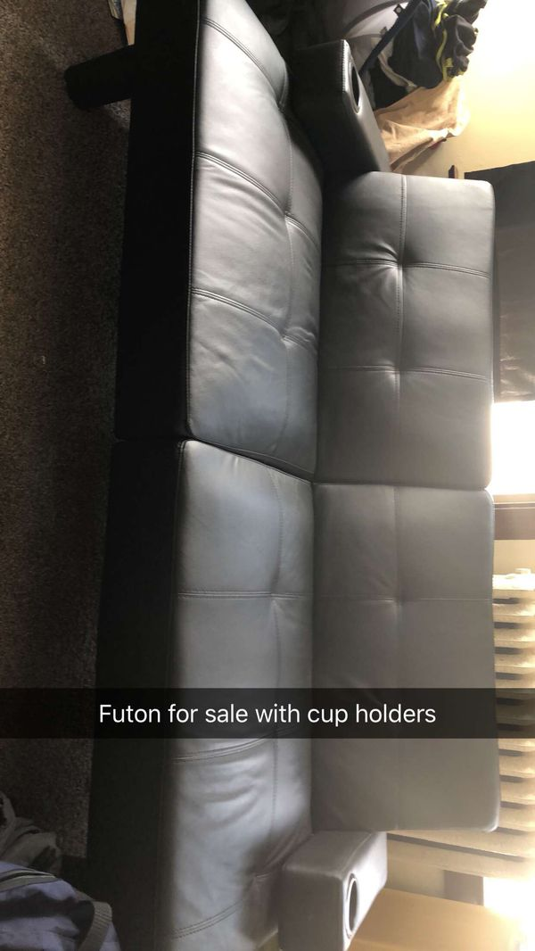 Black leather futon with cup holders