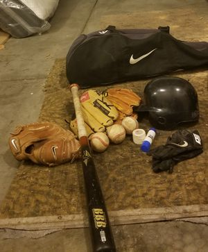 Nike bag with 3 gloves and baseballs helmet all included make offer for Sale in Salt Lake City, UT