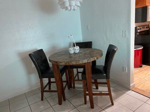 Marble top kitchen table with three chairs for Sale in Carol City, FL