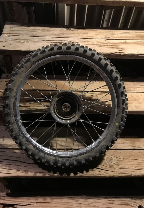 Front dirt bike tire with rim