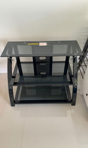 Smoke glass top TV table for Sale in Miami, FL