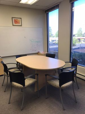 Oval conference table and ten chairs w arm rests for Sale in Burlingame, CA