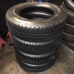 Set Bridgestone Dueler 255/70/18 semi new 95% life $300 including professional installation and tax for Sale in Bellflower, CA