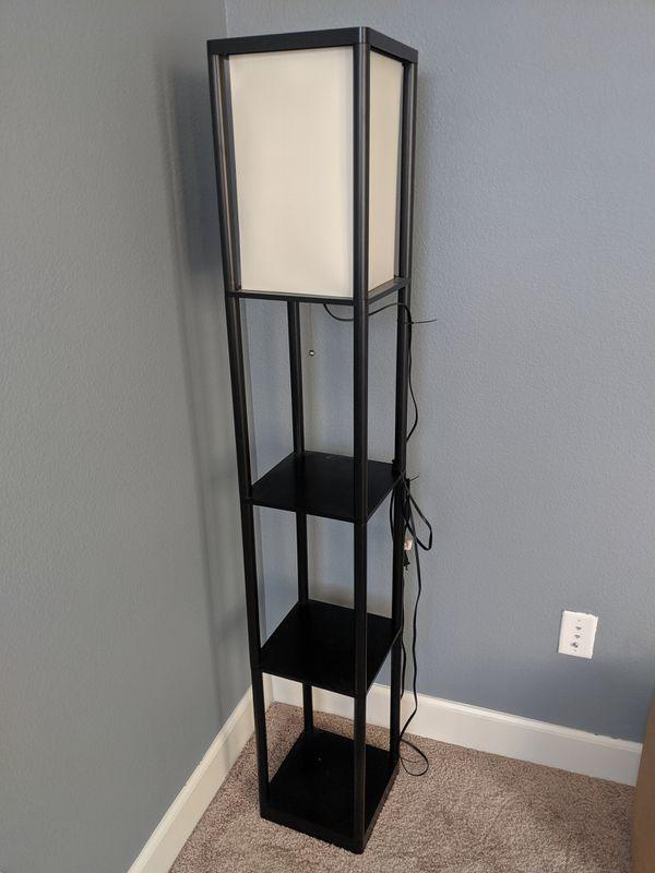 Sofa, small bookshelf, glass shelf, floor lamp
