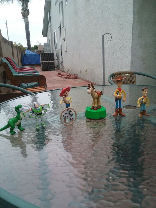 Homie (Cholo) and Toy Story figurines