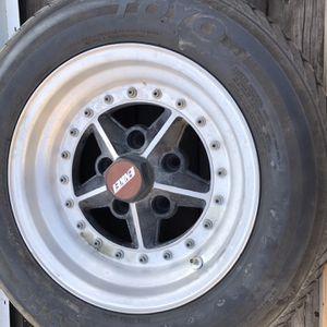 Four Enkie Alumnim Wheels 250-60-14 Tires GM Pattern for Sale in Kennewick, WA