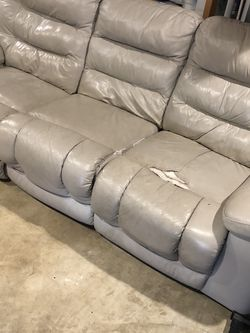 Leather Couch Has Rips Where You Can See . Reclines On Each Side Of The Couch Free Pick Uobtonight for Sale in St. Peters,  MO