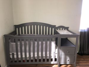 Convertible crib and changing table with mattress included for Sale in Palmdale, CA