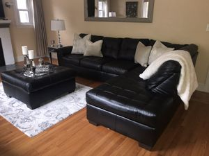 Leather sectional and ottoman for Sale in Smithfield, RI