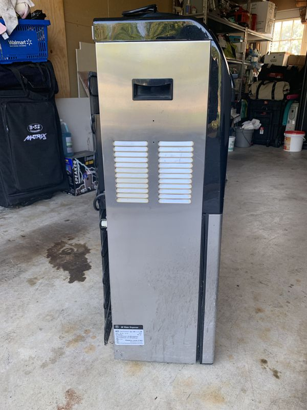 GE Profile water cooler and hot water with attach refrigerator $40.00 OBO text {contact info removed})