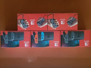 BNIB v2 Nintendo Switch Grey, and Neon Blue/Red for Sale in Clovis, CA