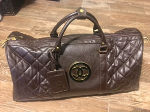 LEATHER CHANEL DUFFLE BAG WITH SERIAL LOGO ON SIDE for Sale in Atlanta, GA