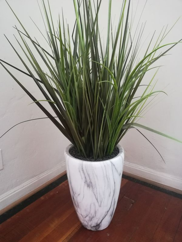 Large faux potted plant