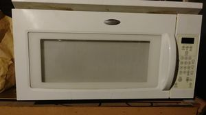 Whirlpool microwave hangs underneath a cabinet or above the stove it does have a light for above the stove as well as exhaust fan for Sale in Cleveland, OH