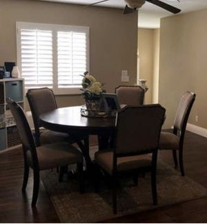 Ashley furniture round dining room table with 5 chairs for Sale in Anaheim, CA